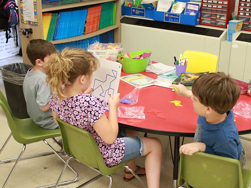 students in the classroom doing puzzle